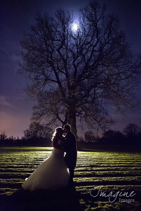 Night shot of wedding couple at Glenbervie House Hotel
